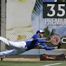 Kansas City Royals' Justin Maxwell makes a flying grab down the right field line on a fly out by San Francisco Giants' Angel Pagan in the third inning of an exhibition baseball game, Friday, March 7, 2014, in Surprise, Ariz The Associated Press