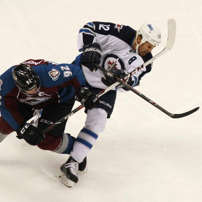 Colorado Avalanche left wing Gabriel Landeskog, left, of Sweden, gets tangled up with Winnipeg Jets center Olli Jokinen, of Finland, while pursuing the puck in the third period of the Avalanche's 3-2 victory in an NHL hockey game in Denver on Sunday, Oct. 27, 2013
