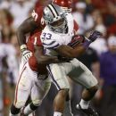 Kansas State runing back John Hubert (33) fights off a tackle by Oklahoma defender Tony Jefferson (1) in the fourth quarter of an NCAA college football game in Norman, Okla., Saturday, Sept. 22, 2012. Kansas State won 24-19. (AP Photo/Sue Ogrocki)