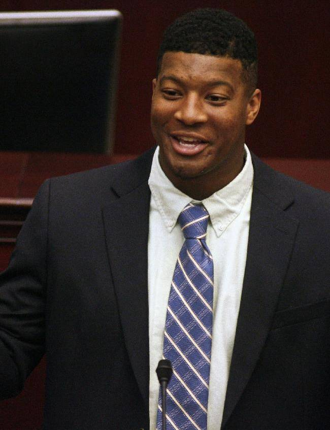 Florida State quarterback and 2013 Heisman Trophy winner Jameis Winston speaks Tuesday April 1, 2014 on the floor of the House of Representatives in Tallahassee, Fla. The Florida legislature honored the football team during Florida State Day at the Capitol for winning the BCS National Championship last January