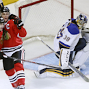 Chicago Blackhawks center Jonathan Toews, a second from left, celebrates his goal with Patrick Kane next to St. Louis Blues goalie Ryan Miller during the first period in Game 3 of a first-round NHL hockey Stanley Cup playoff series game Monday, April 21,