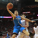 Oklahoma City Thunder forward Nick Collison, left, grabs a rebound against Houston Rockets center Omer Asik during an NBA basketball game in Houston Friday, April 4, 2014 The Associated Press