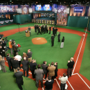New Jersey Gov. Corzine stands in a group with Major League Baseball officials just beyond a pitchers' mound at the new MLB Network Studios Wednesday, Feb. 4, 2009, in Secaucus, N.J., during the indoor dedication of a street outside the studios of baseball's new cable television network. Corzine said up to 350 employees would work in the building that once housed the MSNBC cable news network. (AP Photo/Mel Evans)