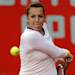 Russia's Anastasia Pavlyuchenkova eyes the ball during her Portugal Open first round tennis match Tuesday, April 30 2013, in Oeiras, outside Lisbon. Pavlyuchenkova defeated Israel's Shahar Peer 6-4, 6-4. 