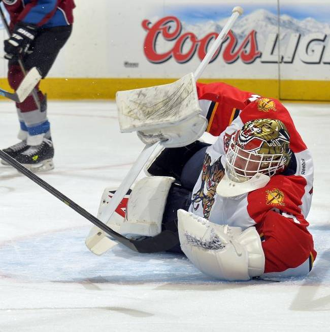 Florida Panthers goalie Tim Thomas makes a save against the Colorado Avalanche during the first period of an NHL hockey game on Saturday, Nov. 16, 2013, in Denver