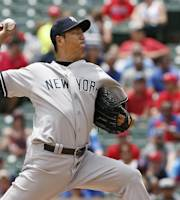 New York Yankees starting pitcher Hiroki Kuroda, of Japan, throws in the first inning of a baseball game against the Texas Rangers in Arlington, Texas, Thursday, July 25, 2013. (AP Photo/Brandon Wade)