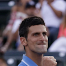 Novak Djokovic, of Serbia, clenches his fist after breaking Alexandr Dolgopolov, of Ukraine, in the second set at the Miami Open tennis tournament, Tuesday, March 31, 2015, in Key Biscayne, Fla. (AP Photo/Lynne Sladky)