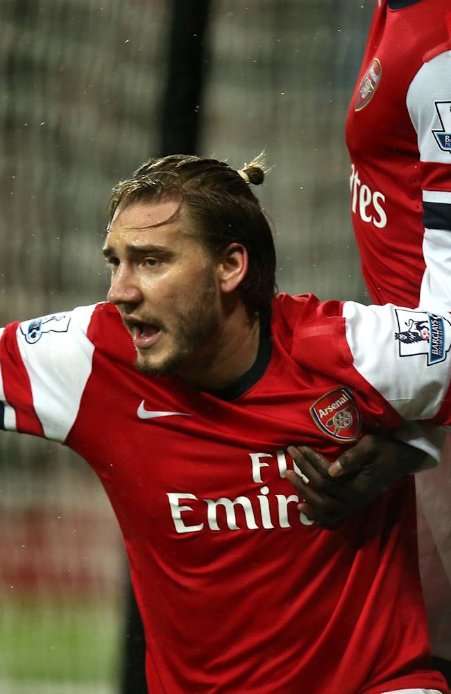 Arsenal's Nicklas Bendtner celebrates scoring  during the English Premier League match against Cardiff at the Emirates Stadium, London Wednesday Jan.  1, 2014