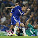 Chelsea's Branislav Ivanovic, left, and Schalke's Sidney Sam challenge for the ball during the Champions League Group G soccer match between Chelsea and Schalke 04 at Stamford Bridge stadium in London Wednesday, Sept. 17, 2014