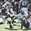 New York Jets quarterback Geno Smith (7) fumbles the ball as he attempts to pass it off to running back John Conner (38) while under pressure from Denver Broncos defensive end DeMarcus Ware (94) during the third quarter of an NFL football game, Sunday, Oc