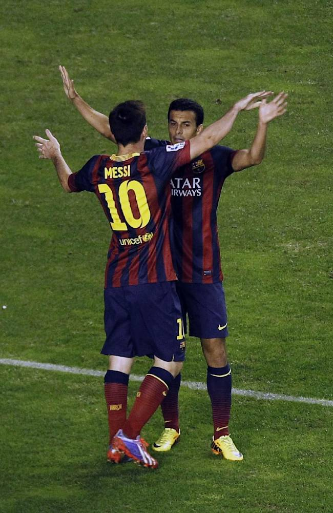 FC Barcelona's Pedro Rodriguez, right,  celebrates his goal with Lionel Messi from Argentina, left, during a Spanish La Liga soccer match against Rayo Vallecano at the Vallecas stadium in Madrid, Spain, Saturday, Sept. 21, 2013