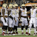 The offensive line stands by as Florida State quarterback Jameis Winston (5) looks to the sideline for the call in the final seconds of an NCAA college football game against Oklahoma State, Saturday, Aug. 30, 2014, in Arlington, Texas. FSU won 37-31 The A