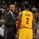 CLEVELAND, OH - APRIL 15:  Head coach Byron Scott of the Cleveland Cavaliers discusses the game with Kyrie Irving #2 during a break in the action against the Miami Heat at The Quicken Loans Arena on April 15, 2013 in Cleveland, Ohio. (Photo by David Liam Kyle/NBAE via Getty Images)