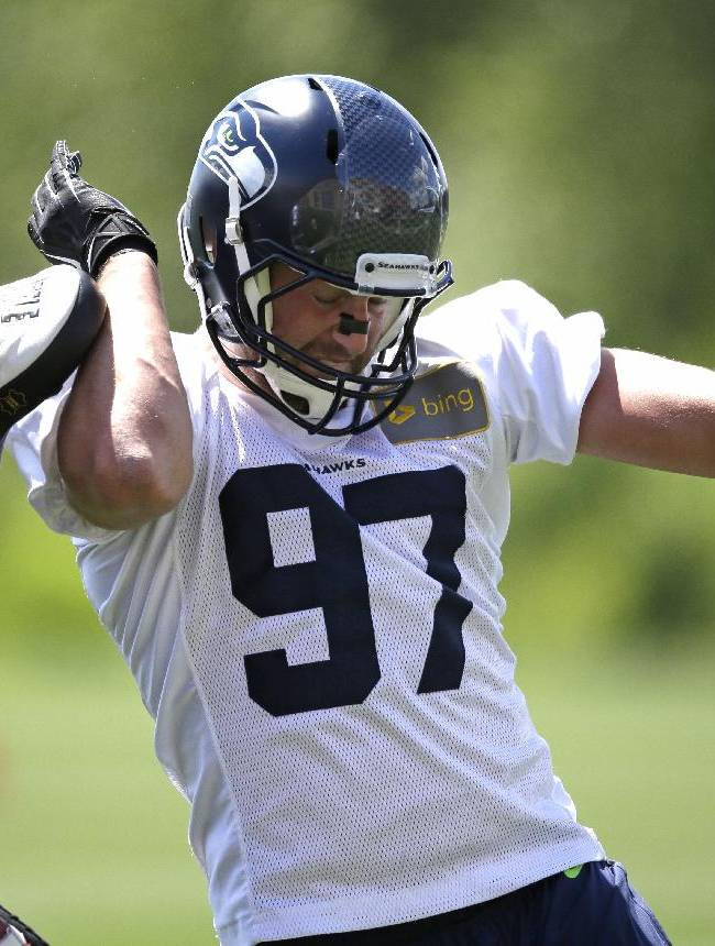 Seattle Seahawks' Cody Bauer runs through a drill during NFL football rookie minicamp Saturday, May 17, 2014, in Renton, Wash