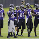 Baltimore Ravens wide receiver Steve Smith, second from left, waits alongside fellow wide receivers before running a drill during a training camp practice, Thursday, July 24, 2014, at the team's practice facility in Owings Mills, Md. (AP Photo) The Associ