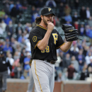 Pittsburgh Pirates relief pitcher Jason Grilli reacts after getting the last out against the Chicago Cubs in a baseball game, Thursday, April 10, 2014, in Chicago. The Pirates won 5-4 The Associated Press