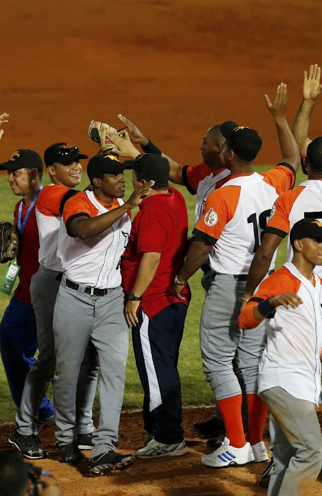 Cuba players celebrate after defeating Puerto Rico 2-1 in a Caribbean Series baseball game in Porlamar, Venezuela, Tuesday, Feb. 4, 2014