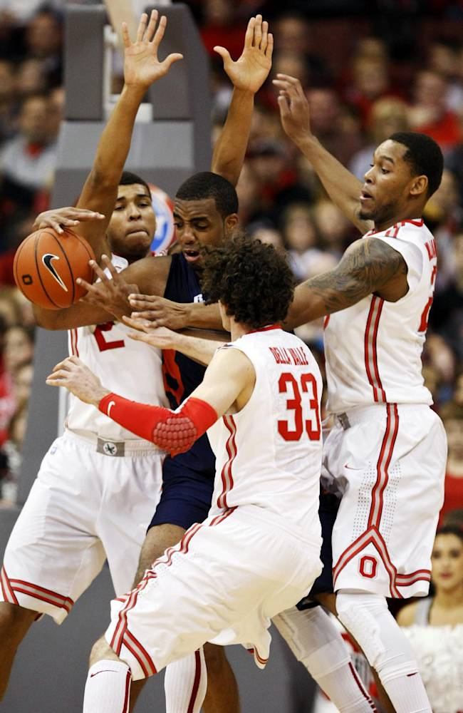 Morgan State's Justin Black (50) works for the ball against Ohio State's Marc Loving (2), Amedeo Della Valle (33) and Amir Williams (23) during the first half of an NCAA college basketball game in Columbus, Ohio, Saturday, Nov. 9, 2013