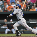 Texas Rangers' Mitch Moreland follows through on a two run home run against the Baltimore Orioles in the fourth inning of a baseball game Monday, June 29, 2015, in Baltimore.(AP Photo/Gail Burton)