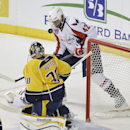 Nashville Predators goalie Carter Hutton (30) blocks a shot as Washington Capitals right wing Joel Ward (42) tries for the rebound in the second period of an NHL hockey game Friday, Jan. 16, 2015, in Nashville, Tenn The Associated Press