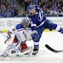 Tampa Bay Lightning right wing Ryan Callahan (24) crashes into New York Rangers goalie Henrik Lundqvist (30), of Sweden, during the second period of an NHL hockey game Wednesday, Nov. 26, 2014, in Tampa, Fla. (AP Photo/Chris O'Meara)