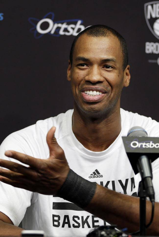 Brooklyn Nets Jason Collins speaks during a news conference before an NBA basketball game against the Chicago Bulls at the Barclays Center, Monday, March 3, 2014, in New York. More than a week after becoming the league's first openly gay player, Collins will finally get to play a home game