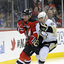 New Jersey Devils' Marek Zidlicky, left, of Czech Republic, battles for position with Pittsburgh Penguins' Pascal Dupuis during the first period of an NHL hockey game Saturday, Nov. 16, 2013, in Newark, N.J The Associated Press