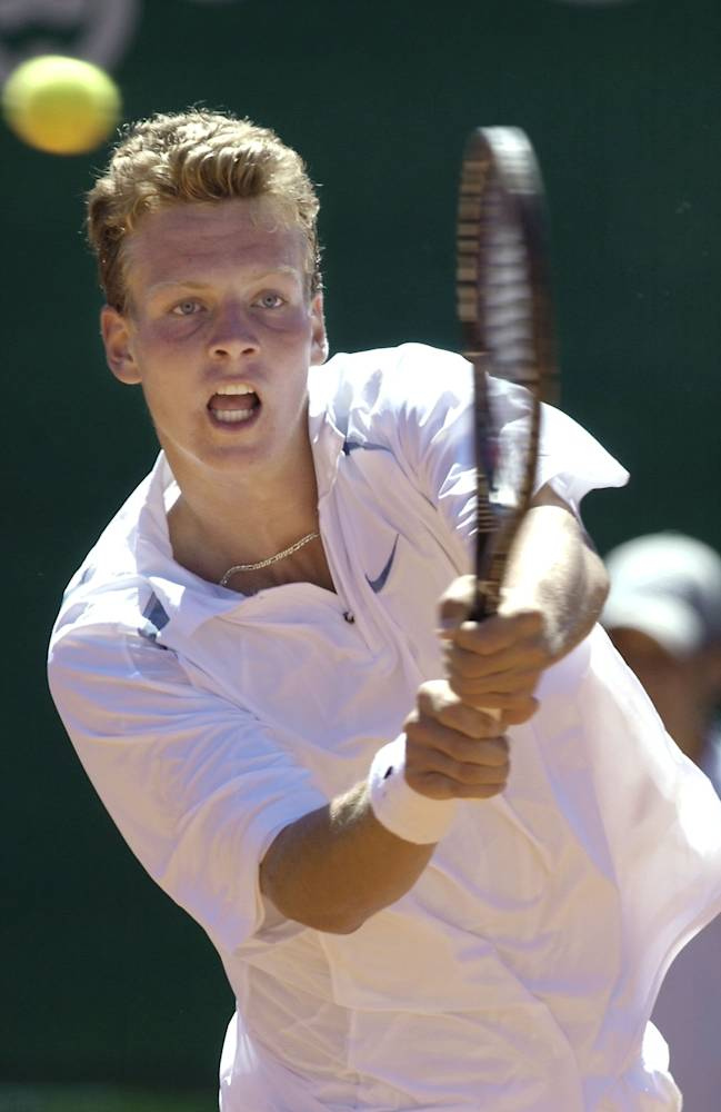 Tomas Berdych from Czech Republic returns a Ball against Ivo Minar from Czech Republic, during the Ebel European Junior U-18 Championships 18 and under in Klosters, Switzerland ond Sunday, July, 28, 2002. Minar won the final with 6:4, 6:2