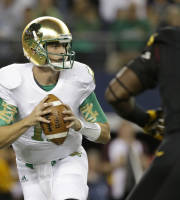 Notre Dame quarterback Tommy Rees looks to pass under pressure from Arizona State defensive lineman Marcus Hardison (12) during the first half of an NCAA college football game Saturday, Oct. 5, 2013, in Arlington, Texas. (AP Photo/LM Otero)
