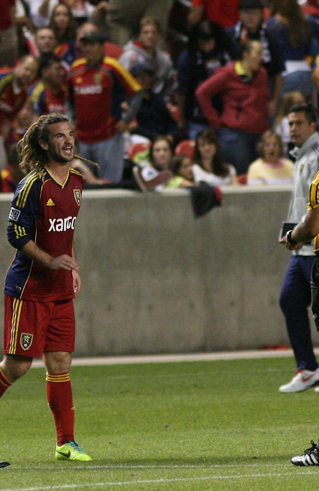 Real Salt Lake midfielder Kyle Beckerman (5) gets a yellow card after arguing with officials during the first half against D.C. United in the U.S. Open Cup of Soccer final, Tuesday, Oct. 1, 2013, in Sandy, Utah