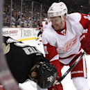 Detroit Red Wings' Daniel Alfredsson (11) works against Pittsburgh Penguins' Brandon Sutter (16) along the boards during the second period of an NHL hockey game in Pittsburgh, Wednesday, April 9, 2014 The Associated Press