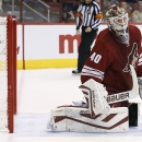 Arizona Coyotes' Devan Dubnyk looks around for the puck but Edmonton Oilers' Ryan Nugent-Hopkins already put the puck in the goal for a score during the first period of an NHL hockey game Tuesday, Dec. 16, 2014, in Glendale, Ariz The Associated Press