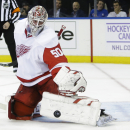 Detroit Red Wings goalie Jonas Gustavsson (50), of Sweden, stops a shot on the goal during the second period of an NHL hockey game Wednesday, Nov. 5, 2014, in New York The Associated Press