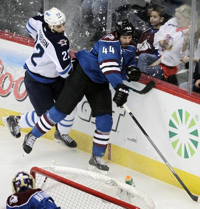 Winnipeg Jets right wing Chris Thorburn (22) checks Colorado Avalanche defenseman Ryan Wilson (44) during the first period of an NHL hockey game in Denver on Sunday, Dec. 29, 2013