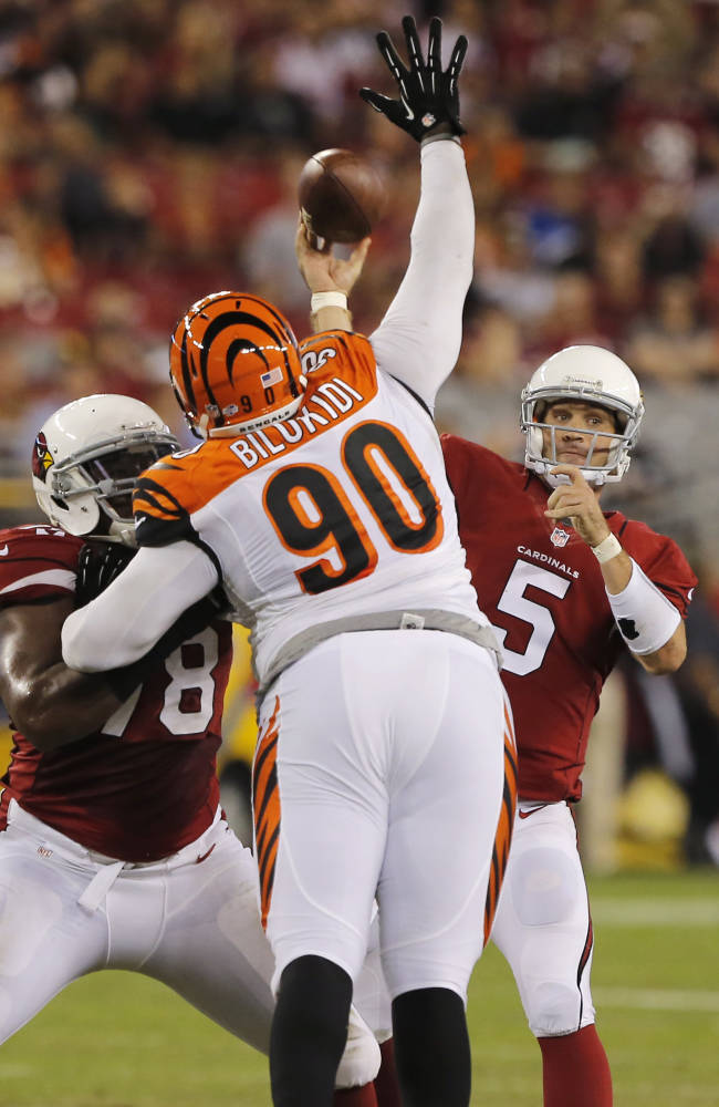 Arizona Cardinals quarterback Drew Stanton (5) throws under pressure from Cincinnati Bengals defensive tackle Christo Bilukidi (90) during the second half of an NFL preseason football game, Sunday, Aug. 24, 2014, in Glendale, Ariz