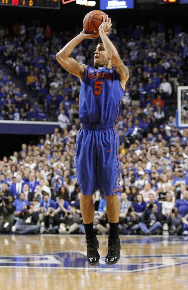 Florida's Scottie Wilbekin shoots an uncontested three-point shot during the second half of an NCAA college basketball game against Kentucky, Saturday, Feb. 15, 2014, in Lexington, Ky. Florida won 69-59