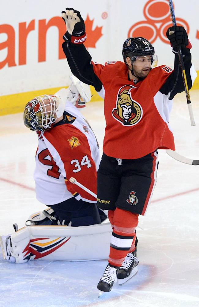 Ottawa Senators' Clarke MacArthur, right, celebrates a goal by teammate Kyle Turris against the Florida Panthers' Tim Thomas during first period of an NHL hockey game in Ottawa, Ontario, on Saturday, Nov. 9, 2013