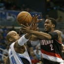 Portland Trail Blazers' Wesley Matthews (2) is fouled by Orlando Magic's Jameer Nelson (14) as he drives to the basket during the first half of an NBA basketball game, Sunday, Feb. 10, 2013, in Orlando, Fla. (AP Photo/John Raoux)