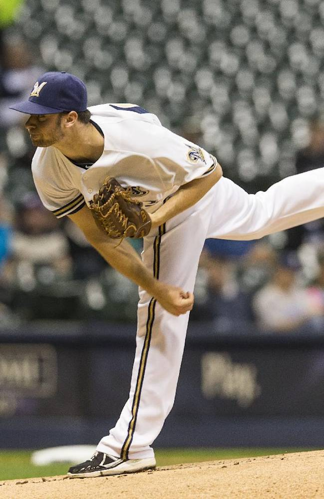 Milwaukee Brewers' Tyler Thornburg pitches to a Chicago Cubs batter during the first inning of a baseball game on Wednesday, Sept. 18, 2013, in Milwaukee