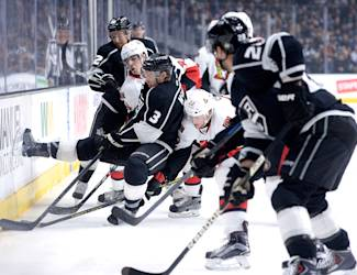 LOS ANGELES, CA - FEBRUARY 26:  Brayden McNabb #3 and Trevor Lewis #22 of the Los Angeles Kings fight for the puck along the boards with Jean-Gabriel Pageau #44 and ot22 during the first period at Staples Center on February 26, 2015 in Los Angeles, California.  (Photo by Harry How/Getty Images)