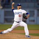 Los Angeles Dodgers starting pitcher Josh Beckett throws to the plate during the first inning of a baseball game against the Detroit Tigers, Wednesday, April 9, 2014, in Los Angeles The Associated Press
