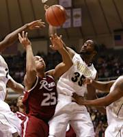 Purdue guards Rapheal Davis (35) and Terone Johnson, right, and Purdue forward Jay Simpson, left, battle Rider forward Junior Fortunat (25) for a rebound in the first half of an NCAA basketball game in West Lafayette, Ind., Sunday, Nov. 17, 2013. (AP Photo/R Brent Smith)