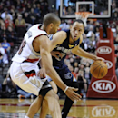 Memphis Grizzlies' Tayshaun Prince (21) drives against Portland Trail Blazers' Nicolas Batum (88) during the first half of an NBA basketball game in Portland, Ore., Sunday March 30, 2014 The Associated Press