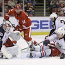 Columbus Blue Jackets defenseman Kevin Connauton (4) stops a goal in front of goalie Sergei Bobrovsky during the second period of an NHL hockey game in Detroit, Tuesday, Dec. 16, 2014 The Associated Press