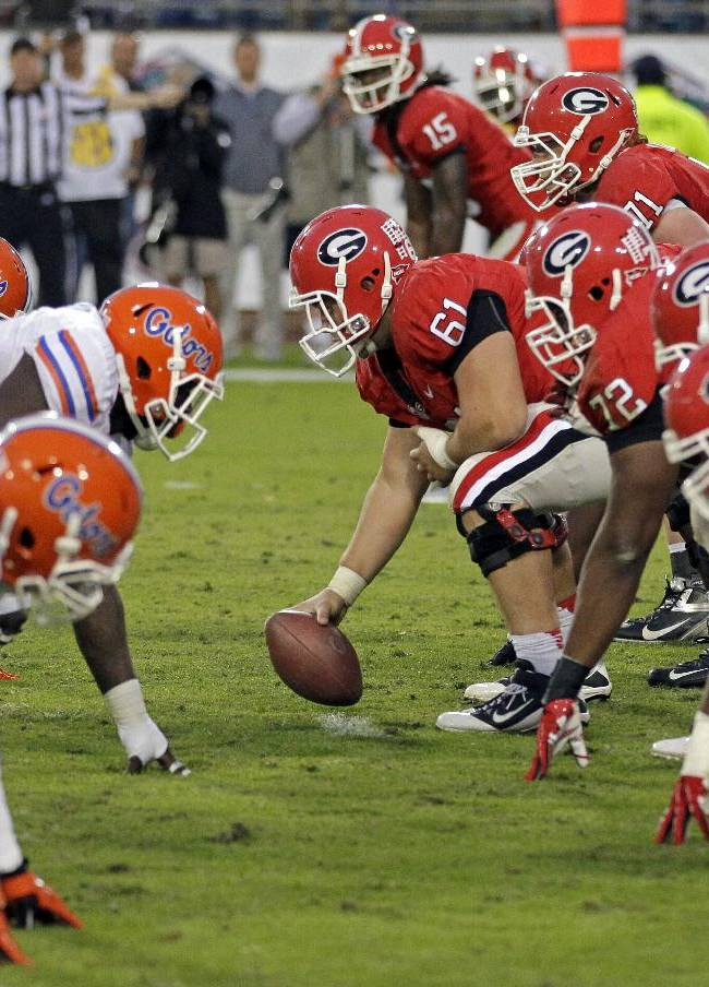 In this Oct. 27, 2012, file photo, The Florida defense, left, lines up for a play against Georgia during the second half of an NCAA college football game in Jacksonville, Fla. Georgia and Florida, teams that began the year with championship aspirations, have been ravaged by injuries and enter their annual Cocktail Party game at Jacksonville staring at the final gasp to make something of their disappointing seasons