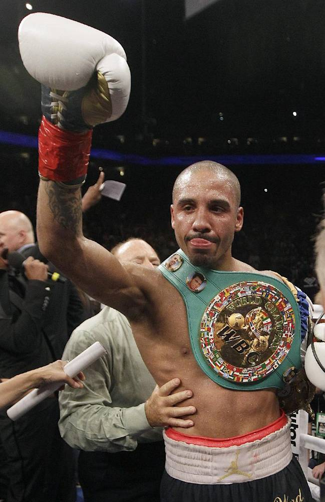 In this Sept. 8, 2012, file photo, Andre Ward celebrates after defeating Chad Dawson in a WBA/WBC super middleweight championship boxing match in Oakland, Calif. Ward has been out of the ring for 14 months, beset by injuries, a spat with his promoter and the inability to find a suitable opponent. The unbeaten super middleweight star returns Saturday against unbeaten Edwin Rodriguez with his eye on bigger fights in 2014
