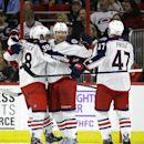 Columbus Blue Jackets' Scott Hartnell (43) celebrates his goal against the Carolina Hurricanes with Boone Jenner (38) and Dalton Prout (47) during the second period of an NHL hockey game in Raleigh, N.C., Friday, Nov. 7, 2014. Carolina won 3-2 in overtime