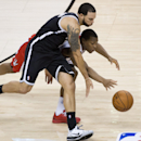 Toronto Raptors guard Kyle Lowry, right, and Brooklyn Nets forward Deron Williams race for the ball during the second half of Game 2 in an NBA basketball first-round playoff series, Tuesday, April 22, 2014, in Toronto The Associated Press