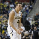 Michigan forward Mitch McGary (4) reacts after scoring against Virginia Commonwealth in the first half of a third-round game of the NCAA college basketball tournament Saturday, March 23, 2013, in Auburn Hills, Mich. (AP Photo/Duane Burleson)