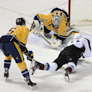 Nashville Predators goalie Pekka Rinne (35), of Finland, gloves a shot by Colorado Avalanche left wing Jamie McGinn (11) as he is defended by forward Viktor Stalberg (25), of Sweden, in the second period of an NHL hockey game on Tuesday, March 25, 2014,